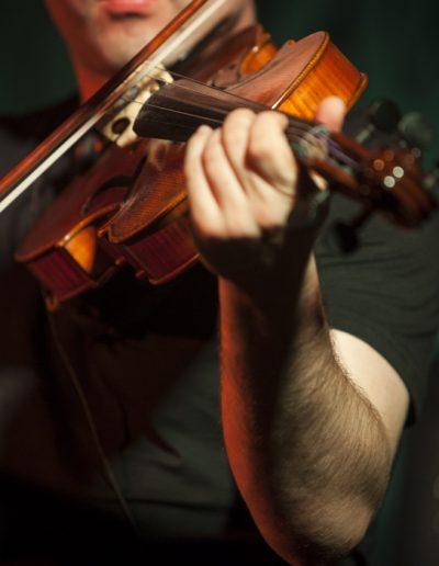 Joueur de violon. Détail.