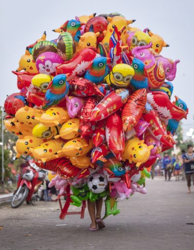 Travel photography. Balloon seller. Vientiane, Laos
