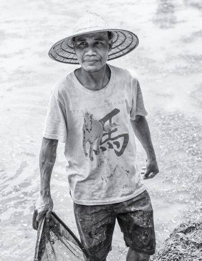 Portrait d'agriculteur travaillant dans des rizières. Laos. Massimo Municchi photographe